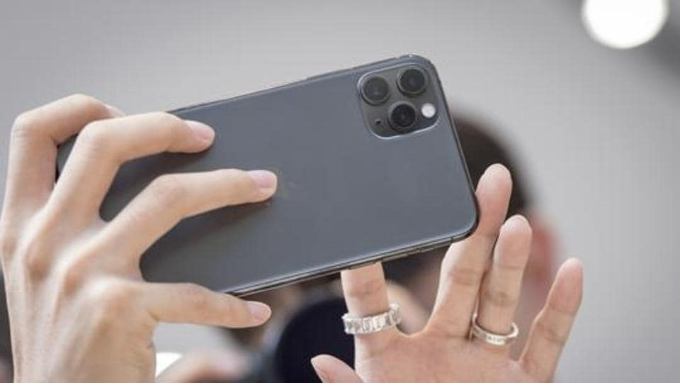 An attendee views the Apple Inc. iPhone 11 Pro Max smartphone after an event in Cupertino, California, U.S., on Tuesday, Sept. 10, 2019. Apple unveiled new iPhones with camera enhancements and improved battery life, making incremental tweaks to lure buyers ahead of a more substantial overhaul of its handsets in 2020.