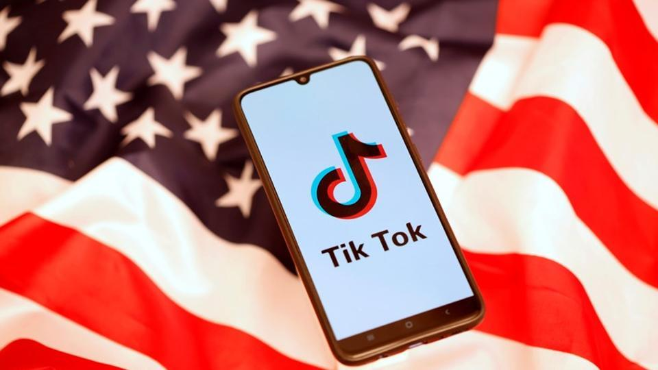 TikTok logo is displayed on the smartphone while standing on the U.S. flag in this illustration picture taken, November 8, 2019.