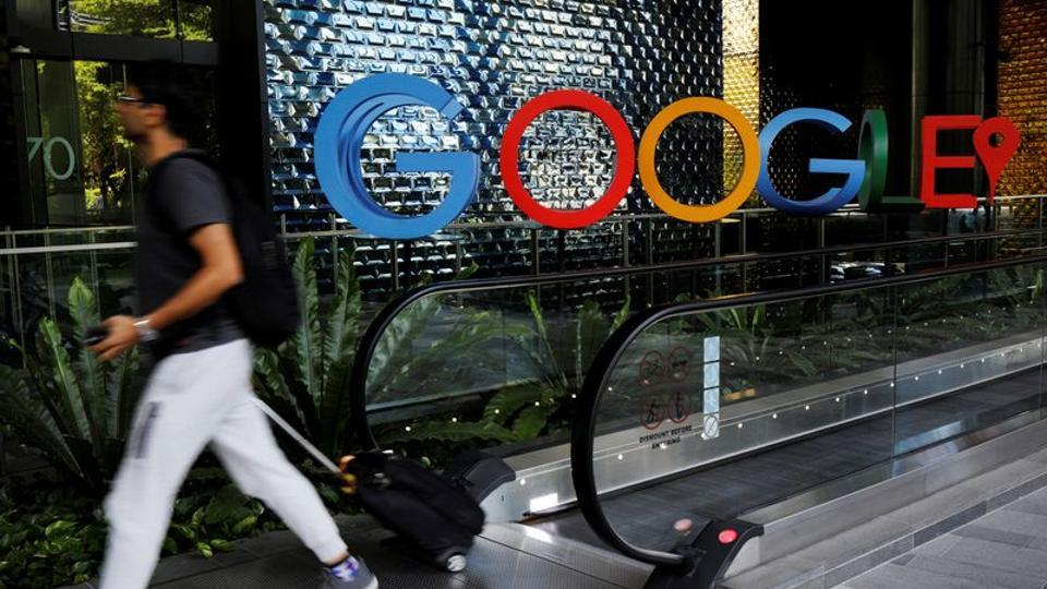 A man passes a Google signage outside their office in Singapore May 24, 2019.
