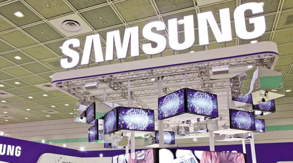 Visitors walk past the Samsung Electronics Co. booth.