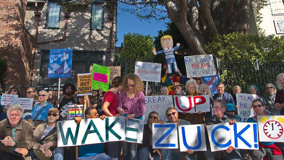 """People from various cities in the Bay Area gathered outside Zuckerberg's house on Presidents' Day, which falls on Monday, to stage a """"Wake the ZUCK Up"""" protest by chanting slogans and making noises with whistles to press him for making changes to his political ads policy."""