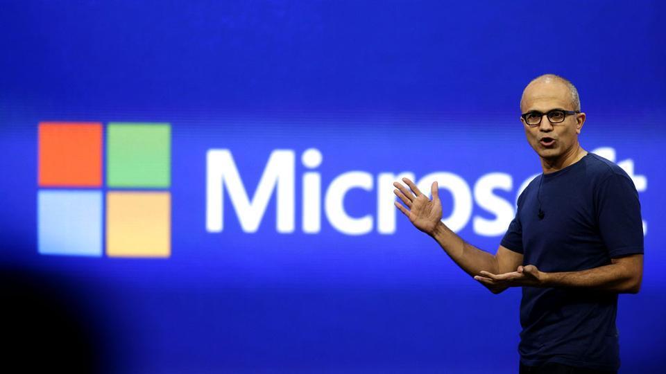 Microsoft CEO Satya Nadella gestures as he speaks during his keynote address in San Francisco, California.