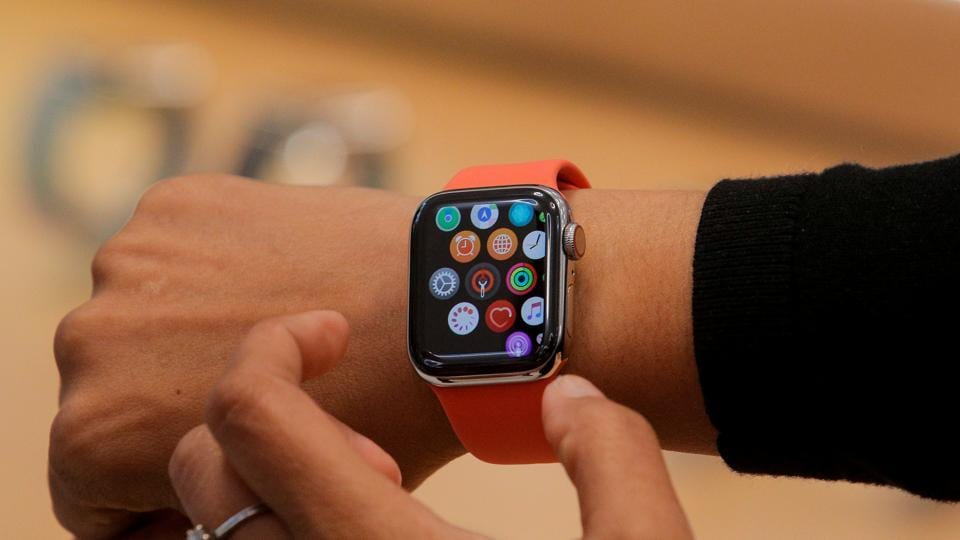 An Apple Store employee shows the new Series 5 Apple Watch during the preview of the redesigned and reimagined Apple Fifth Avenue store in New York, U.S., September 19, 2019.