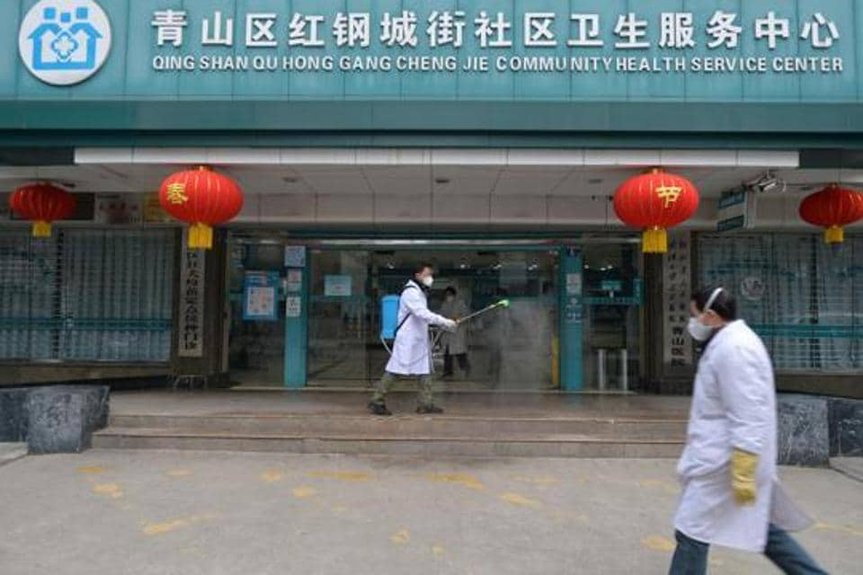 A doctor disinfects the entrance of a community health service center, which has an isolated section to receive patients with mild symptoms caused by the novel coronavirus and suspected patients of the virus, in Qingshan district of Wuhan, Hubei province, China February 2, 2020. Picture taken February 2, 2020