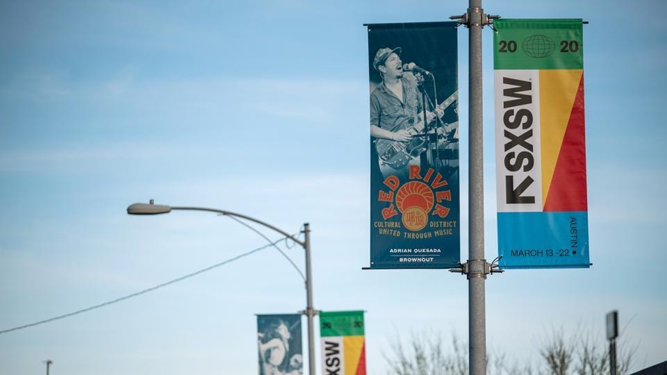 An event flag for SXSW blows in the wind after the music and tech festival was cancelled over growing concerns related to the coronavirus outbreak in Austin, Texas, U.S. March 6, 2020.