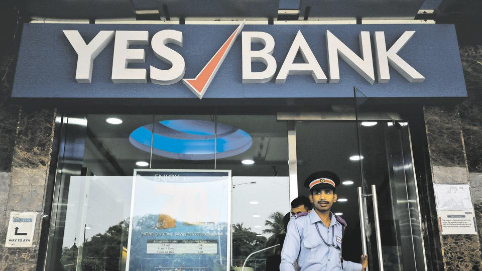A watchman steps out of a Yes Bank branch in Mumbai, India.