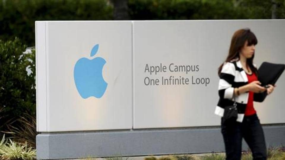 A woman enters Apple Inc.'s headquarters in Cupertino, California, U.S., on Thursday, Aug. 25, 2011. Apple Inc. Chief Executive Officer Steve Jobs, who transformed the company he started at age 21 from a personal-computer also-ran into the world's largest technology company, resigned Wednesday. Photographer: Noah Berger/Bloomberg