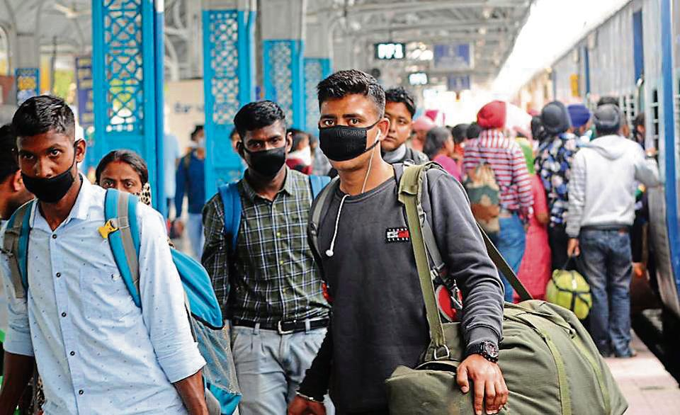 Patiala,India-21 March 2020: People wearing protective masks as a precaution from coronavirus at Railway Station in Patiala on Saturday, March 21, 2020.Photo by Bhart Bhushan Hindustan Times.