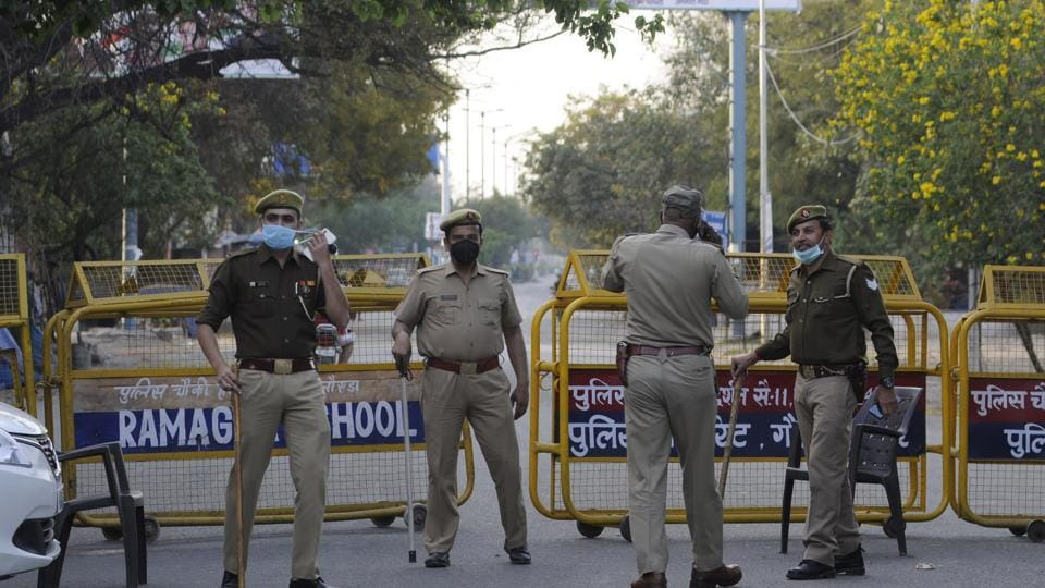 Noida police stand by the sealed border that connects Delhi and Ghaziabad. The border was sealed on Sunday. The Indian government then went on to announce the 21-day lockdown on Tuesday (March 24).