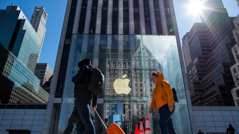 People pass by Apple store in 5av as it's closed to public due to the coronavirus disease (COVID-19) in New York City, New York, U.S.