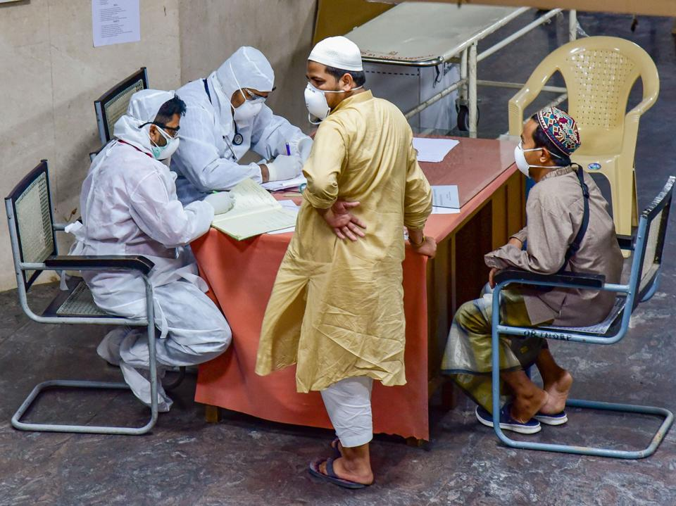 Hyderabad: Medics interact with Indonesian tourists at a COVID-19 helpdesk, in the wake of deadly coronavirus, at Hyderabad Gandhi Hospital, Monday, March 16, 2020.