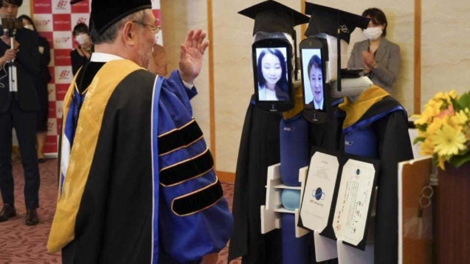 Robots walked up to the stage to receive the degrees on behalf of the students.