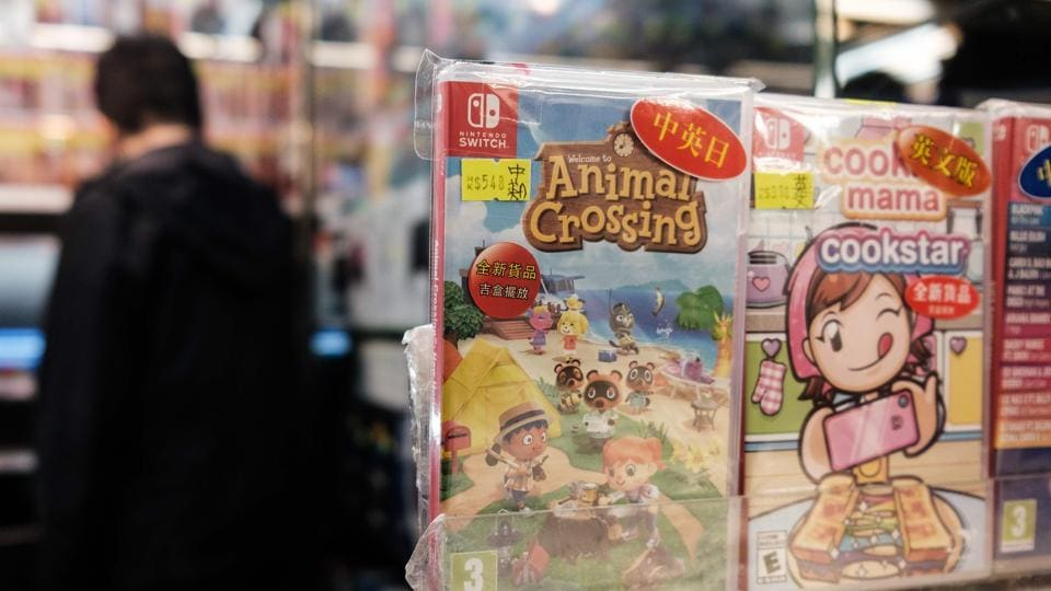 A copy of Nintendo computer game Animal Crossing: New Horizons is displayed in a shopping mall as a customer browses other games in Hong Kong on April 10, 2020.