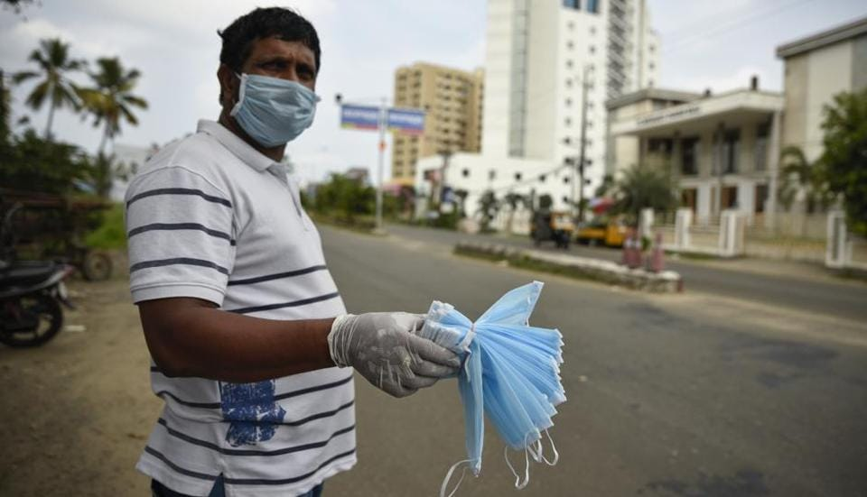 An Indian man sells face masks by a roadside in Kochi, Kerala, India, Saturday, May 2, 2020. The southern state has made wearing face masks mandatory in public places and work places as part of measures to curb the spread of the new coronavirus.